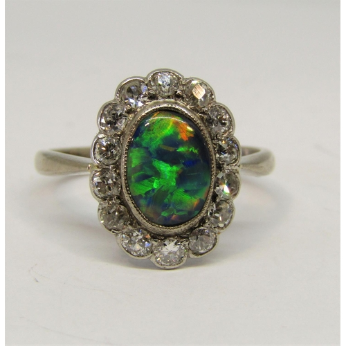 1387 - Good quality 18ct white gold black opal and diamond cluster ring, ring head 15 x 12mm approx, size Q...