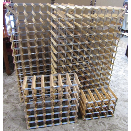 A pair of contemporary wine racks with pine and galvanised steel strap work construction, each to hold 112 bottles, together with two smaller 36 and 12 bottles examples (4)