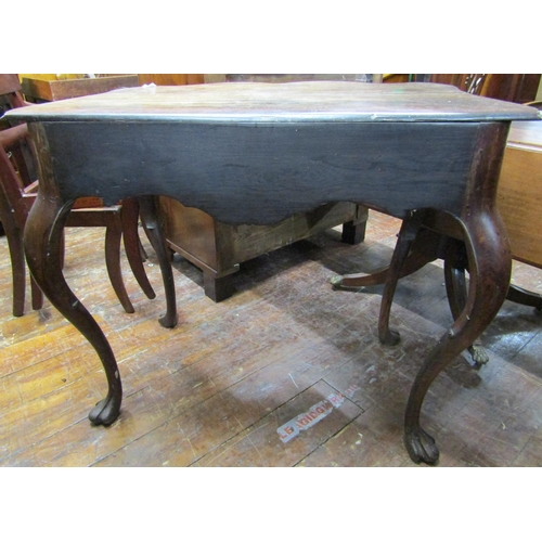 2594 - A late 18th century Portuguese side table in rosewood, the shaped top over a double serpentine shape...
