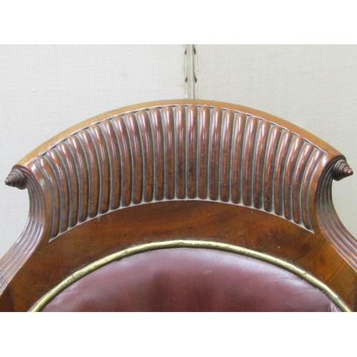 2626a - A good quality Regency mahogany library chair with reeded borders and swept and scrolled crest, rais...