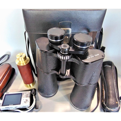 634 - A mixed lot to include a large pair of field binoculars by ANU, 26cm high, together with a further s...