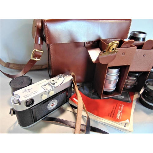656 - A collection of vintage Leica cameras and lenses to include DBP M4-1273 151, DBP M2 1112496, 1:4/135...