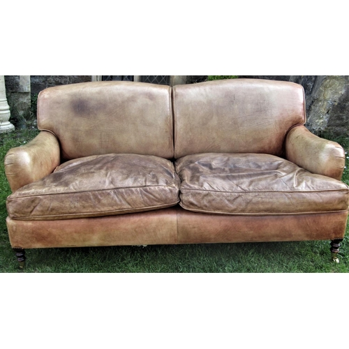 2704 - Good George Smith 'Howard' leather sofa in a light tan colourway raised on turned supports, 185 cm w...