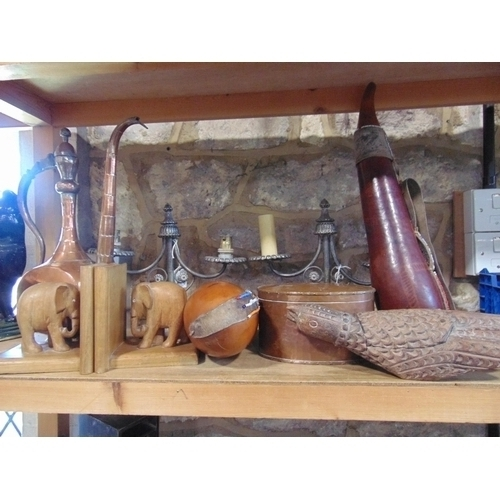 655 - A mixed miscellaneous lot to include a pair of twin branch wrought iron candelabra, a planished copp...