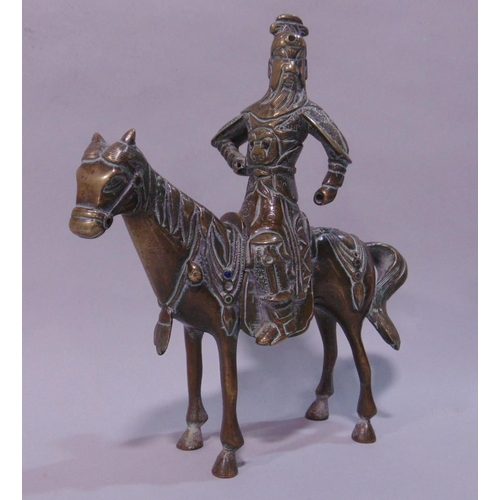 738 - Japanese bronze figural study of a Samurai type warrior on horseback, fitted with various colourful ...