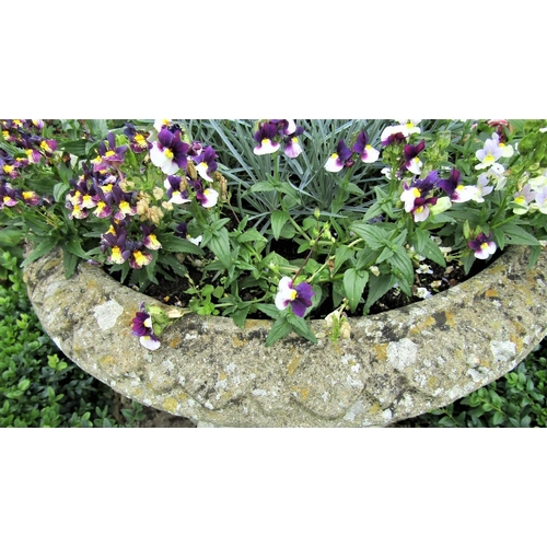 16 - A reclaimed campana shaped garden urn with fluted panels, within egg and tongue borders, 75cm high
