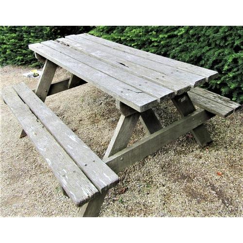 18 - A weathered teak picnic bench, 152cm long