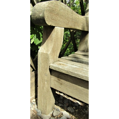 32 - A weathered teak wood garden bench, 240cm wide, reduced in height