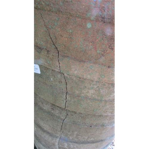 33 - A weathered garden planter of tapering ribbed form (af) 70cm high