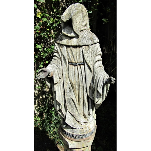 4 - A good quality weathered figure of a hooded monk, raised on a hexagonal plinth with ecclesiastical d...