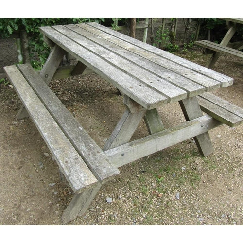 50 - A weathered teak picnic table, 152cm long