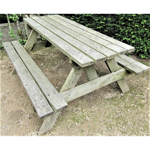 51 - A weathered teak picnic table, 152cm long