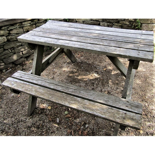 54 - A weathered teak picnic table, 122cm long