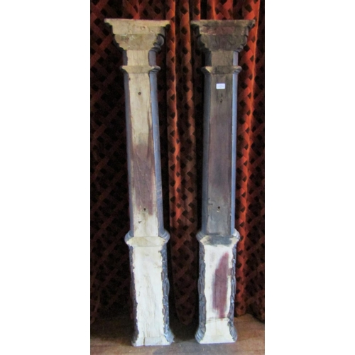 132 - Pair of pine floorstanding columns of simple tapering form with geometric carved detail, 68cm high