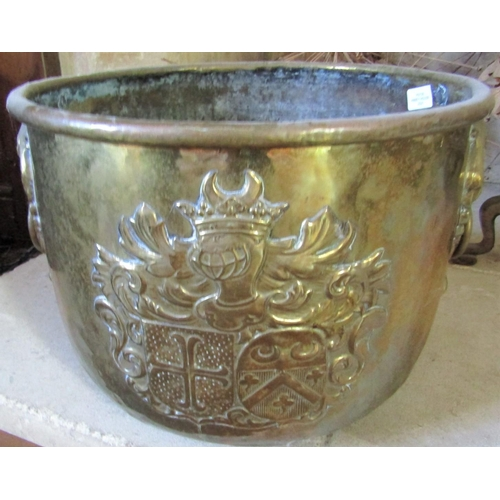 138 - A hammered brass jardinière - 20th century, with armorial crest and ring handles, 40cm diameter