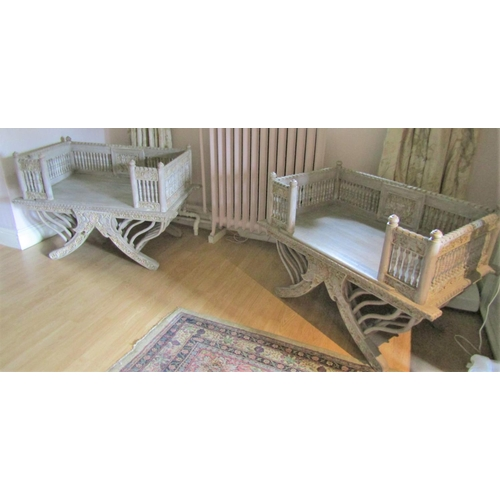 155 - Pair of contemporary Indian Howdahs with limed finish, carved detail and turned spindle mouldings an...