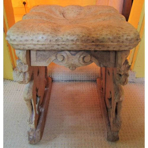 162 - 19thcentury continental pine and limewood stool with simulated cushioned top, the supports form by s...