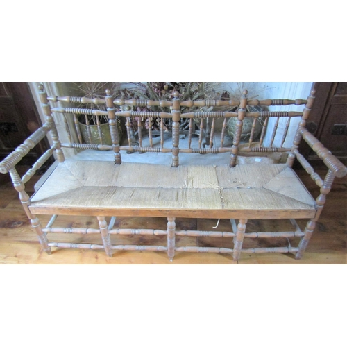 177A - 19th century beech wood settle with turned mouldings and rush seat, 152cm