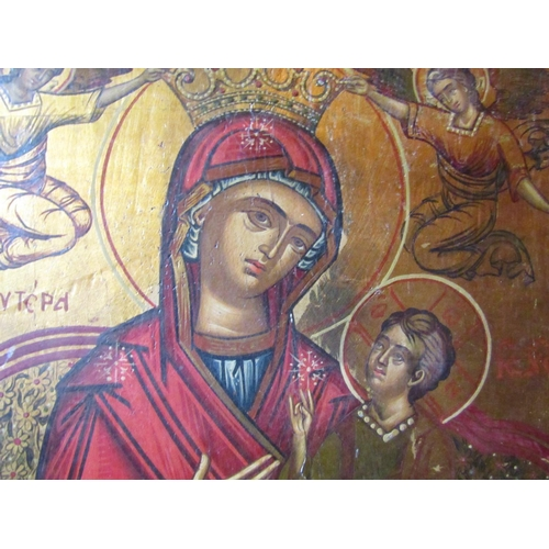 188 - An icon of the Madonna and Child with angels above, in a gilded interior, 70 x 48cm