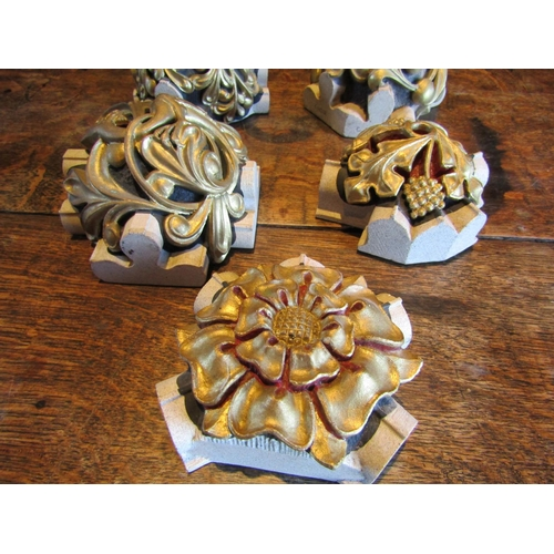 242 - Five reconstituted bosses with hand painted and gilded finish, examples from cathedrals and ecclesia...