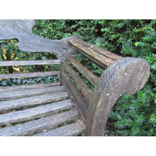 11 - An old teak garden bench in the Lutyens manner (some restoration required) 260cm wide