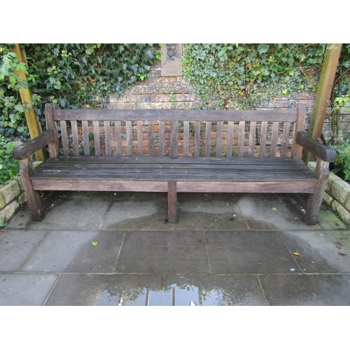 12 - A good quality weathered teak park bench, 240cm wide