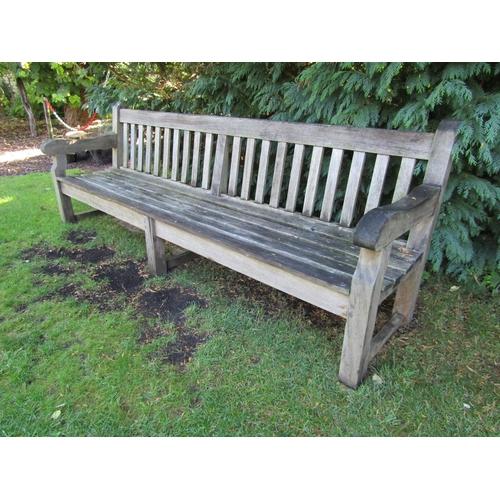 40 - A good weathered teak wood garden bench, 240cm wide