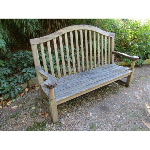 43 - A weathered teak wood garden bench, 160cm wide