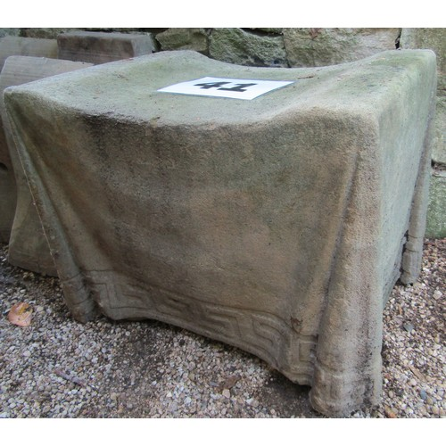 41 - A concrete stool with simulated fabric finish