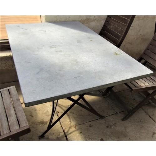 61 - A vintage style café table, the rectangular top zinc lined, 120cm x 80cm, raised on an ironwork base