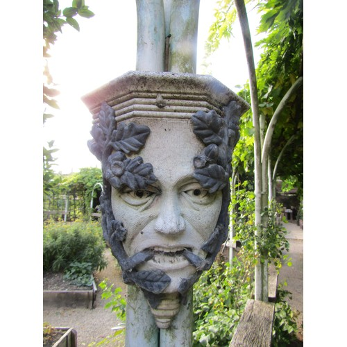 37 - Pair of reconstituted stone green man wall bosses overlaid in lead