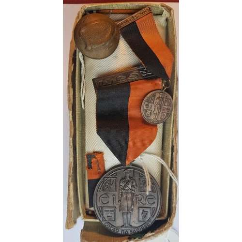 9 - A 1917 to 1921 Service Medal (Black and Tan) in original presentation box, along with Ribbon, a 1917...