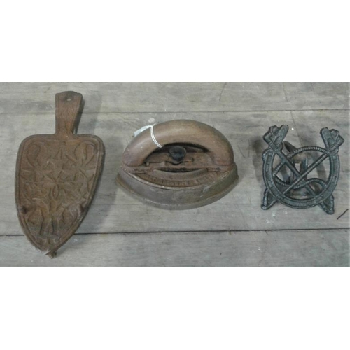 32 - Iron Trivet, Teapot Stand and one other implement...