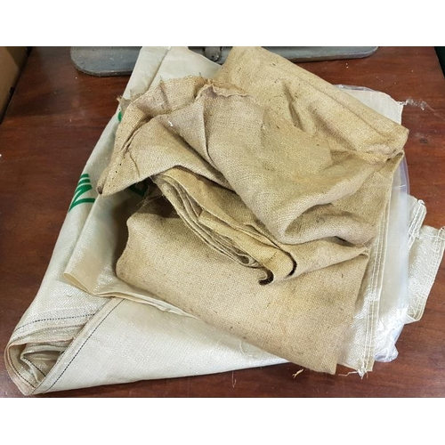 88 - Bundle of Old Meal Bags, and a Collection of Commemorative Irish Newspapers...