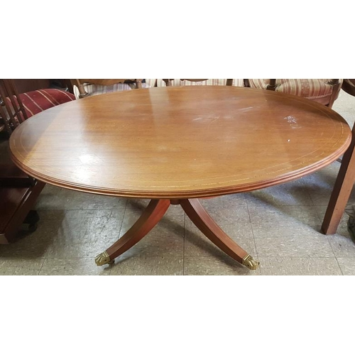 111 - Inlaid Mahogany Coffee Table of Oval Form on a four splay pod with brass Lion's paw feet, c.47in x 2...
