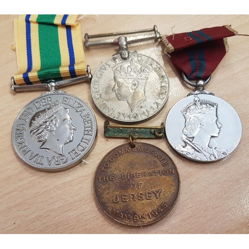 292 - Four British Medals - India 1939-45 Medal, Liberation of Jersey 1946, Iraq Medal and 1953 Queen Eliz...
