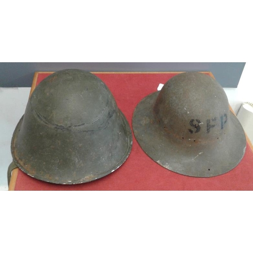 305 - Two World War II Helmets...