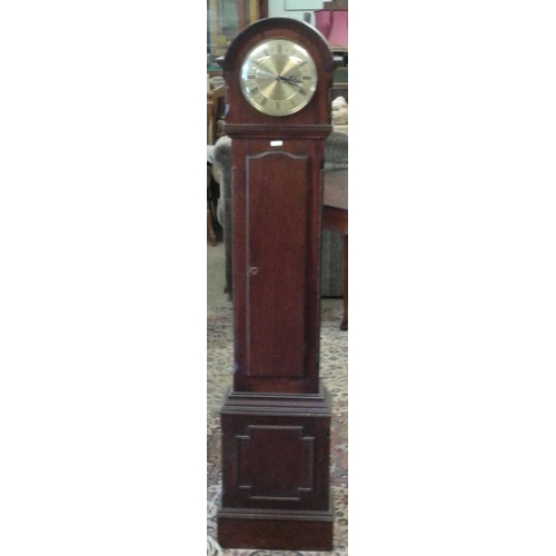 499 - Mahogany Case Granddaughter Clock with electric mechanism, c.56in tall...
