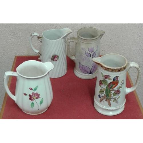 563 - Four Victorian Floral Pattern Dresser Jugs...