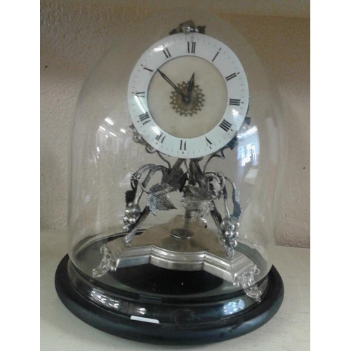 565 - Silver Plated Clock under a glass dome...