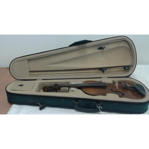 618 - Violin in Green Case, label inside reads 'Stradivarius Cremonensis'...