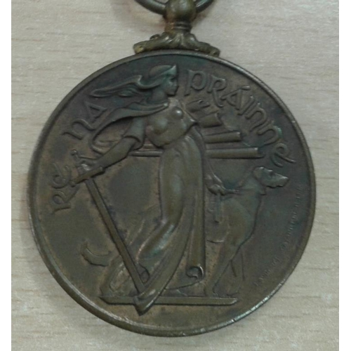 314 - Re na Prainne Medal 1939 - 1946 and a Holy Communion Medal...