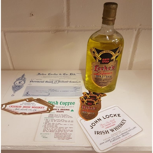 319 - Locke's Distillery Interest Lot to include a Bottle (liquid is not whiskey), Labels, Cheque, etc....