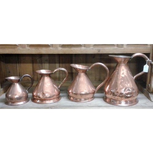 670 - Set of Four Old Copper Measures...