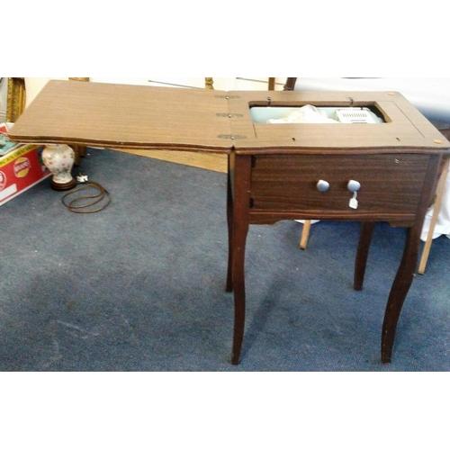 47 - Sewing Machine in Cabinet, closed c.21in wide...