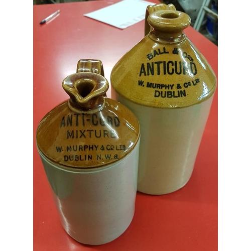 56 - Two <em>W. Murphy & Co., Dublin Anti-Curd Mixture</em> Jars...