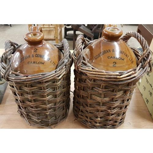 81 - Pair of <em>Corcoran & Co. Ltd., Carlow</em> Two Gallon Whiskey Jars in Original Wicker Casing...
