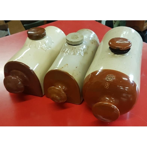 132 - Three Traditional Stoneware Hot Water Bottles...