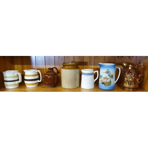 12 - Six Old Dresser Jugs and an Earthenware Jar...