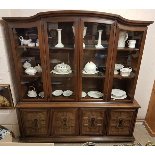 36 - Large Oak Display Cabinet, the arched top with four glazed doors on a base with four solid cupboard ...